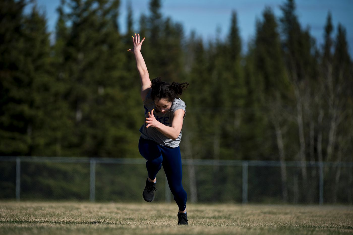 Hailey Williams launches into a run across the infield of the Delta High School track on May 15, 2020. (Marc Lester / ADN)