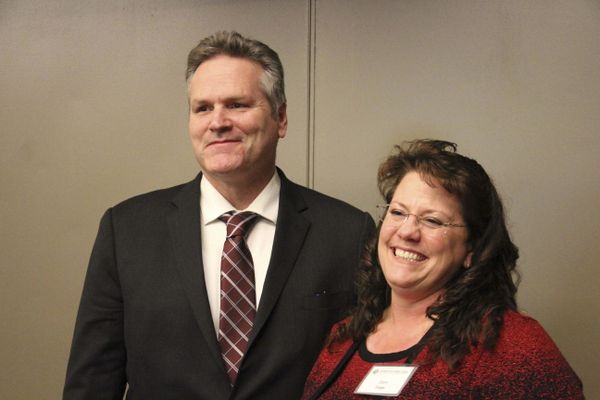 Alaska Gov.-elect Mike Dunleavy, left, poses with Corri Feige, whom Dunleavy named Wednesday, Nov. 14, 2018, during a speech in Anchorage, Alaska, as his commissioner of Natural Resources. Feige has spent her career working in the energy sector, including as a geophysicist and consultant and in management-level positions. (AP Photo/Mark Thiessen)