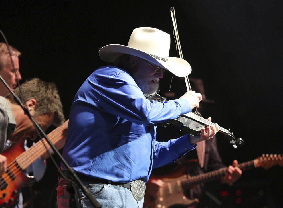 Charlie Daniels and musicians with The Charlie Daniels Band perform as the opener for Alabama at the Fabulous Fox Theatre on Friday, April 14, 2018, in Atlanta. (Photo by Robb Cohen/Invision/AP)