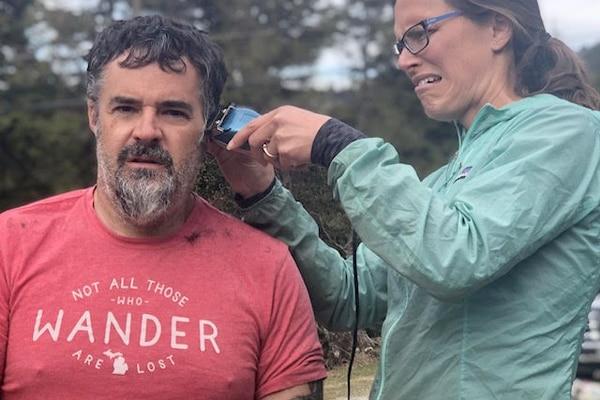 Don Rearden receives a haircut from his wife. Annette Rearden. (Photo courtesy Don Rearden)