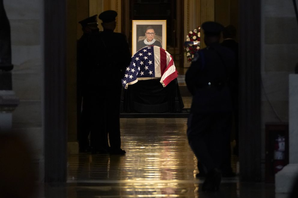 On Friday, Justice Ruth Bader Ginsburg became the first woman to lie in state at the U.S. Capitol. A week after her death, the honor marks the third day of services in Washington for Ginsburg, the second woman to serve on the high court and one who, in her 80s, became a cultural icon. MUST CREDIT: Washington Post photo by Jabin Botsford