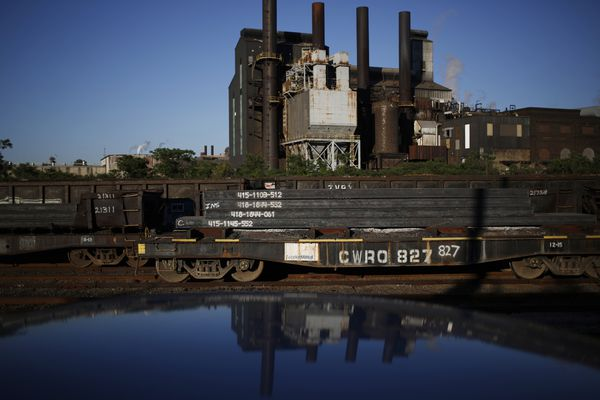 Steel slabs sit on flatcars after being manufactured at the ArcelorMittal steel mill complex in Cleveland, Ohio. Bloomberg photo by Luke Sharrett