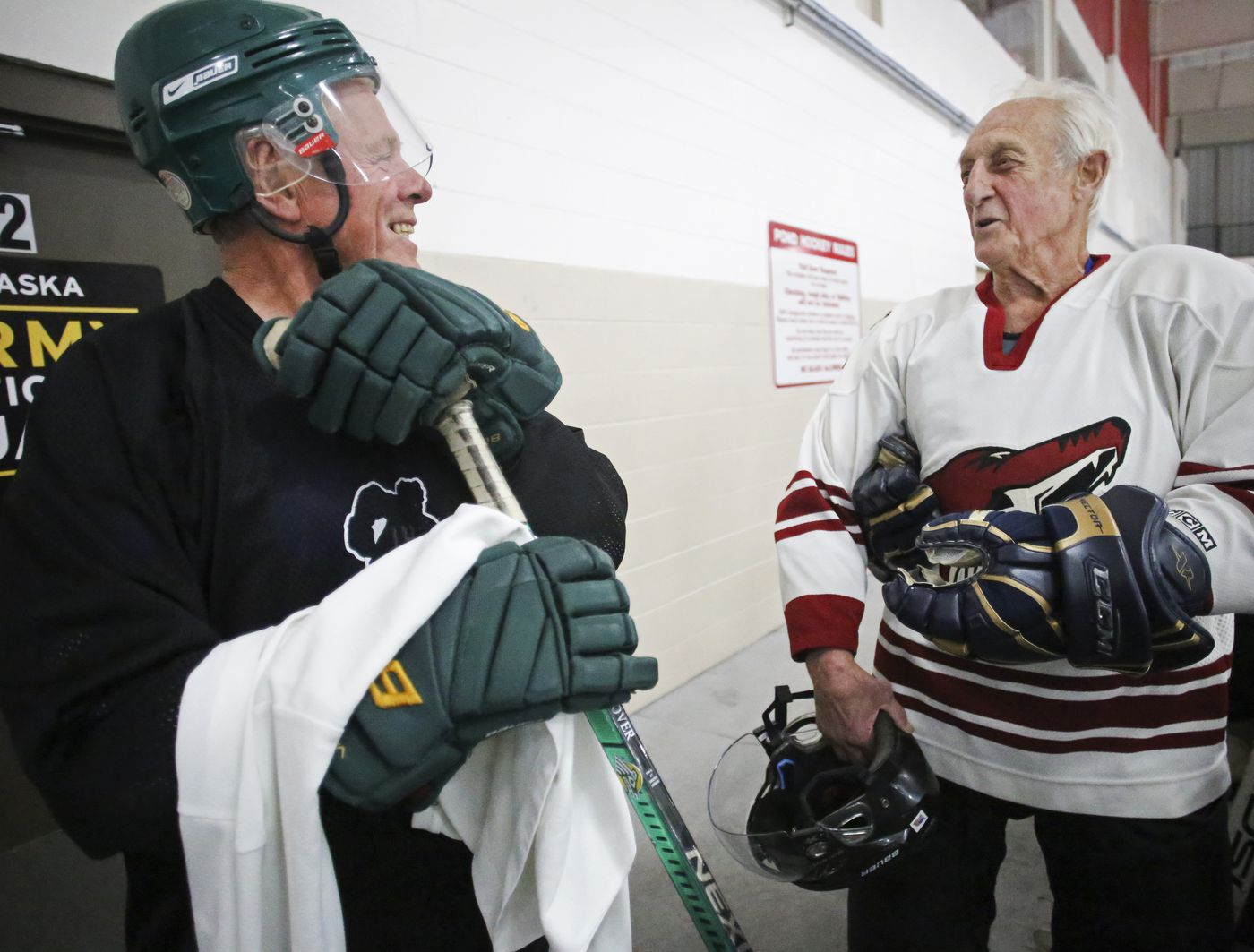 Brush Christiansen, left, and Jimmy Reese talk before heading out onto the ice for a game with the Forty-Niners Hockey Club last month at the O'Malley Ice & Sports Center. (Emily Mesner / ADN)