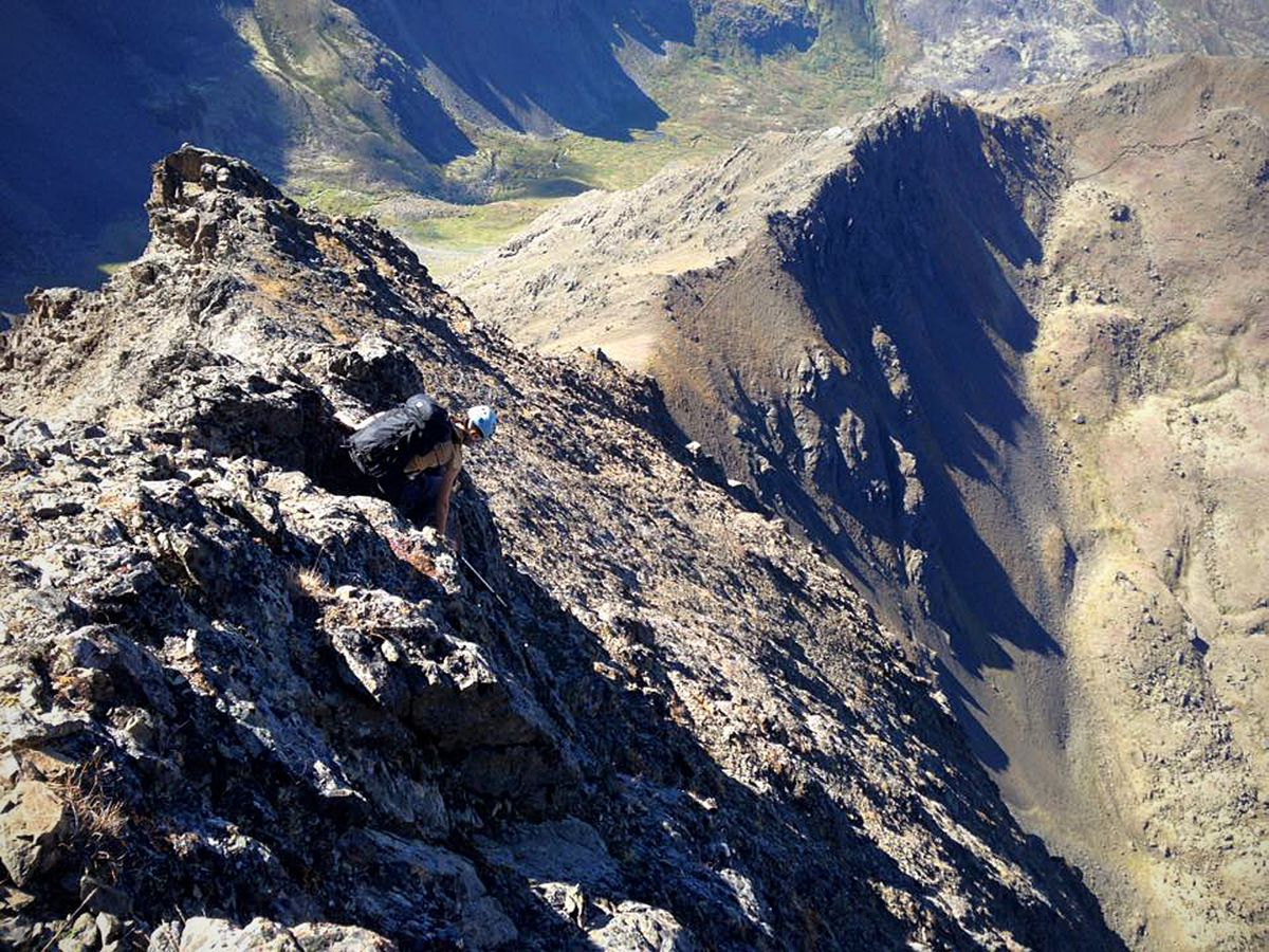 "The ridge to Cantata Peak is riddled with loose, crumbling rock many describe as ""Chugach crud."" (Vicky Ho / Alaska Dispatch News)"