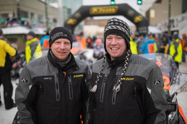 Iron Dog teammates Rurik Lindner, left, and Andy Swenson at the ceremonial start of the 2017 race on Saturday, Feb. 18, 2017. Both are sons of veteran Iditarod racers, Sonny Lindner and 5-time Iditarod champion Rick Swenson. (Loren Holmes / Alaska Dispatch News)