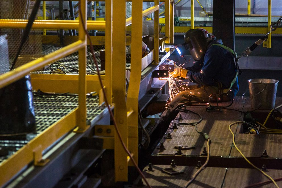 A welder works earlier this year on the new coal-fired power plant at UAF. (JR Ancheta / University of Alaska Fairbanks)