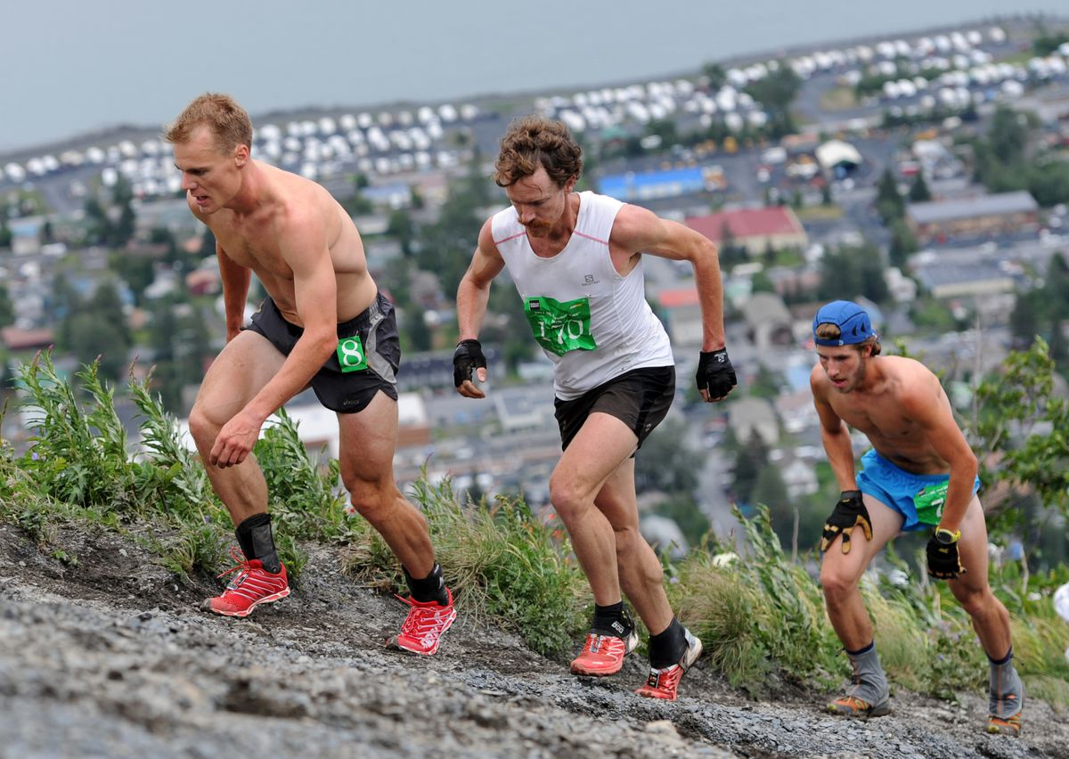 Eric Strabel, Rickey Gates and Wylie Mangelsdorf ascend the mountain in their eventual order of finish in the 2013 Mount Marathon race in Seward. (Erik Hill / ADN archive 2013)