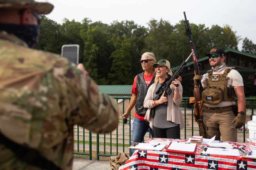 Georgia Republican congressional candidate Marjorie Taylor Greene poses for a photo holding an AR-15 rifle during an event in Ringgold, Ga., on Sept. 19. Photo by Jessica Tezak for The Washington Post