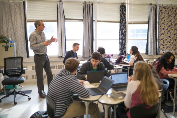 John Ruhlin coaches his students in a close reading of the novel Broken April by Albanian author Ismael Kadare, Tuesday, April 26, 2017 at West High School. The 11th graders are taking Ruhlin's International Baccalaureate literature class. (Loren Holmes / Alaska Dispatch News)