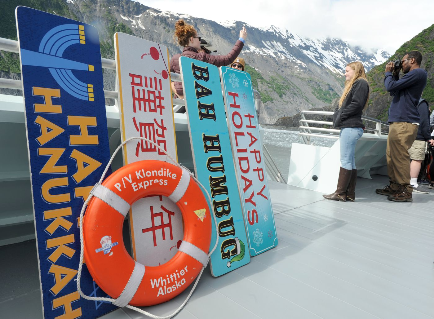 Signs are available for people to use in portraits with glaciers and other scenery as a backdrop aboard the Klondike Express. (Anne Raup / ADN)