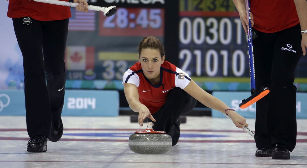 USA's Jessica Schultz releases the stone to her sweepers during a round robin session against Canada at the 2014 Winter Olympics, Feb. 16, 2014, in Sochi, Russia. (Morry Gash / Associated Press archive 2014)