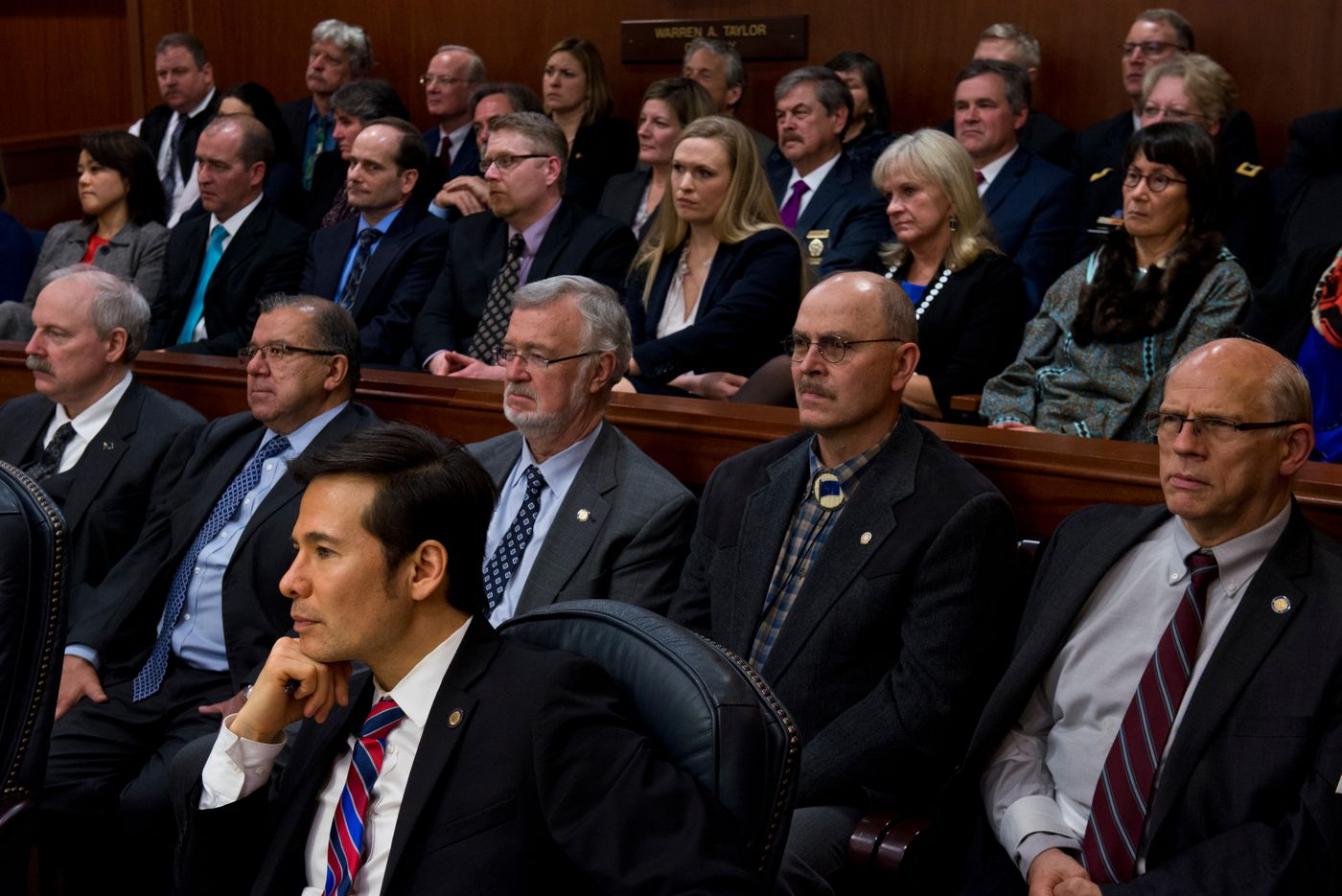 Members of the Alaska Legislature, as well as members of Gov. Bill Walker's Cabinet, staff and family, listen to the State of the State speech.