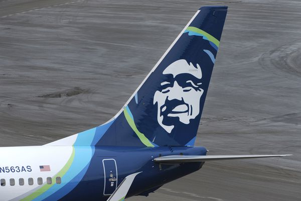 An Alaska Airlines Boeing 737 parked at a passenger gate at Ted Stevens Anchorage International Airport on Thursday, Jan. 28, 2016. (Bill Roth / ADN)
