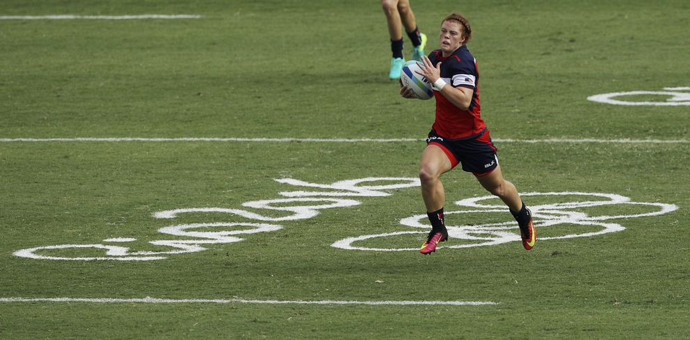 Alev Kelter heads to the goal line in Monday's win overFiji. (REUTERS / Phil Noble)