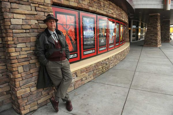 Mike Dunham loiters before the opening of the Magnificent Seven at the Regal Cinemas Stadium 16 at the Tikahtnu Commons in Anchorage, Alaska on Friday, September 23, 2016. (Bob Hallinen / Alaska Dispatch News)