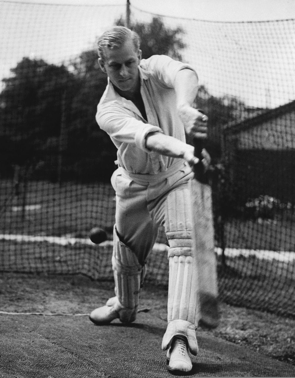 FILE - In this July 31, 1947 file photo, Lt. Philip Mountbatten, whose marriage to Princess Elizabeth has been set for November 20, bats at the nets during cricket practice at the Petty Officers' Training Center, Corsham, England. Buckingham Palace says Prince Philip, husband of Queen Elizabeth II, has died aged 99. (AP Photo/File)