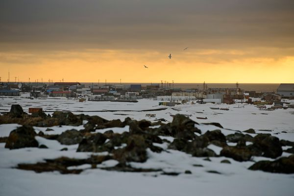 The horizon glows at sunset in this view over the village of Savoonga on April 22, 2017. The village of about 700 is on the northern coast of St. Lawrence Island in the Bering Sea. (Marc Lester / Alaska Dispatch News)