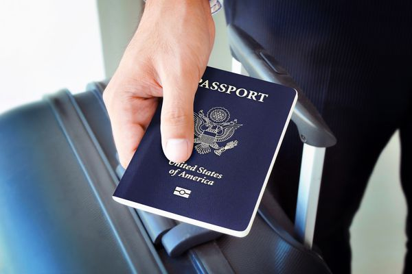 Hand holding U.S. passport (Getty Images)