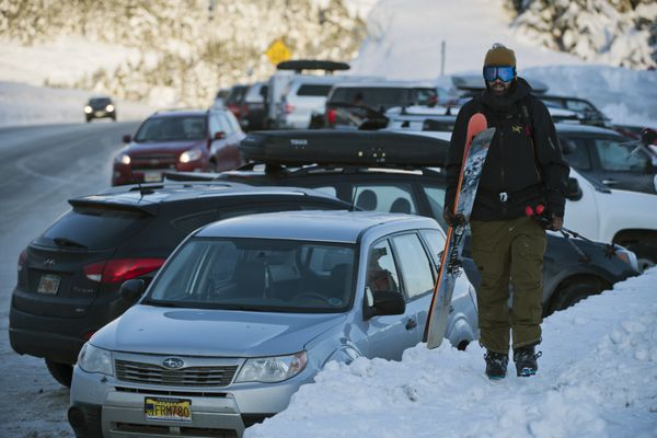 Zach Worthington of Anchorage returns to the parking area after skiing near Tincan Peak at Turnagain Pass on December 31, 2020. (Marc Lester / ADN)