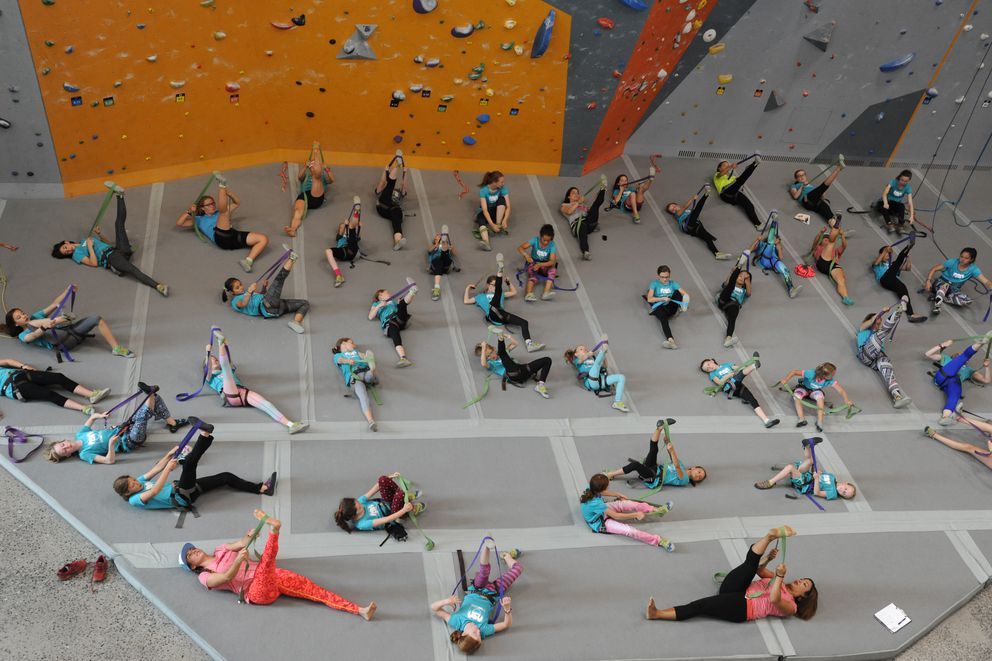 Girls ages 8-18 warm-up before participating in a Fast and Female event with four-time Olympian Kikkan Randall, pro climber Chelsea Rude, and elite female athletes from the community at the Alaska Rock Gym in Anchorage on Thursday, July 27, 2017. Randall said Fast and Female is an organization dedicated in keeping girls involved in sports. (Bill Roth / Alaska Dispatch News)