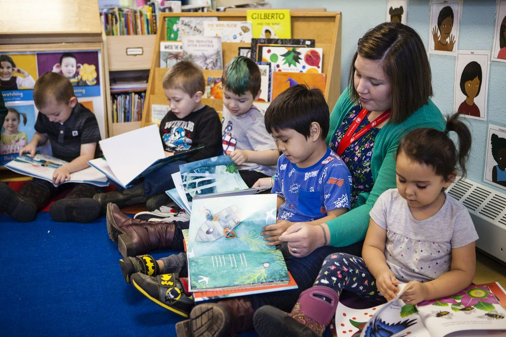 A Tlingit and Haida Head Start teacher in Juneau shares some of the Baby Raven Reads books with students. Head Start partnered with Sealaska Heritage to expand the program to nine additional communities in 2017. (Photo by Nobu Koch)