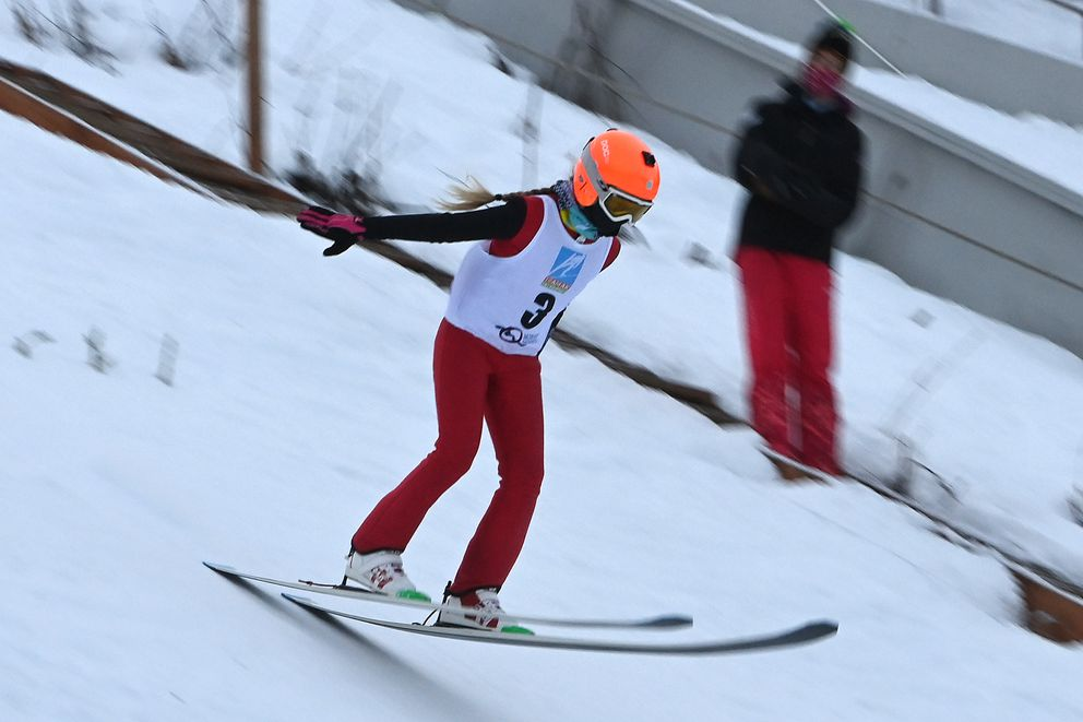 Eleven-year-old Julia Oswald of Team AK lands a jump while competing on the 40-meter hill. (Bill Roth / ADN)