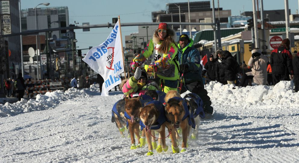 Monica Zappa drives her team down Fourth Avenue during the ceremonial start on Saturday. (Bob Hallinen / Alaska Dispatch News)