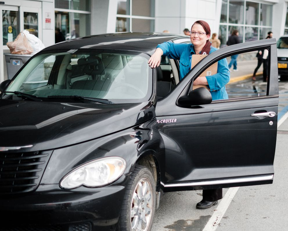 Gesine Jacobs at the airport with with her 2008 Chrysler PT Cruiser, which she rents for about $35 to $40 a day on Turo. (Young Kim / Alaska Dispatch News)