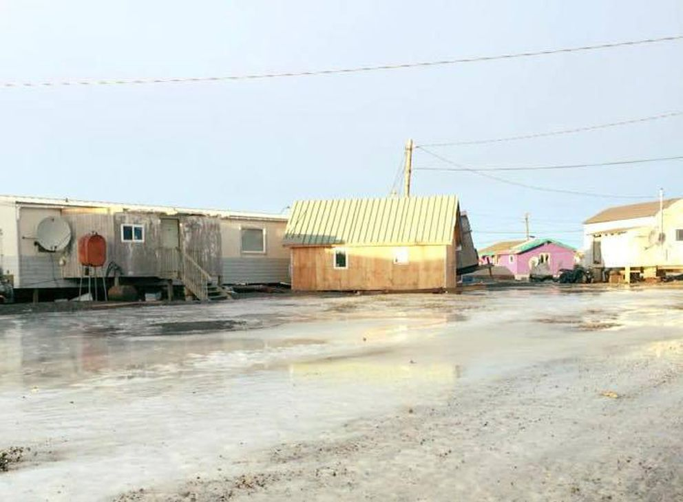 Strong winds knocked a partially constructed house off its foundation and sent it skating across an icy road in Quinhagak on Dec. 22, 2017. (Derek Kusiak via KYUK)