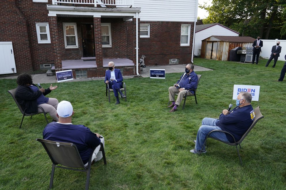 Democratic presidential candidate former Vice President Joe Biden listens during a campaign event with steelworkers in the backyard of a home in Detroit, Wednesday, Sept. 9, 2020. (AP Photo/Patrick Semansky)