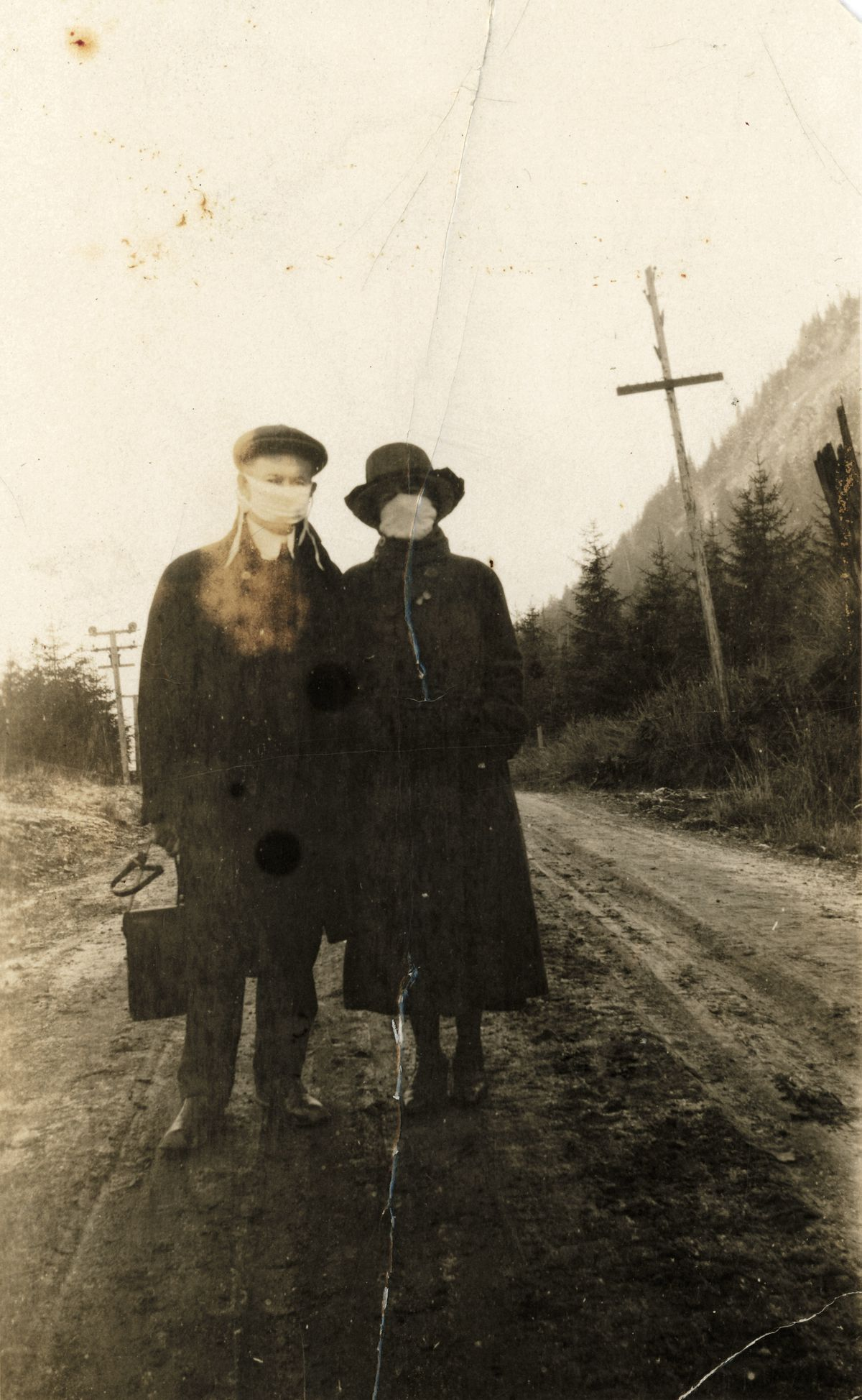 Harry and Carrie Dott wear masks during the 1918 Influenza pandemic in Southeast Alaska. (Credit :P593-09 Alaska State Library Harry & Carrie Dott Photo Collection) ONE TIME USE