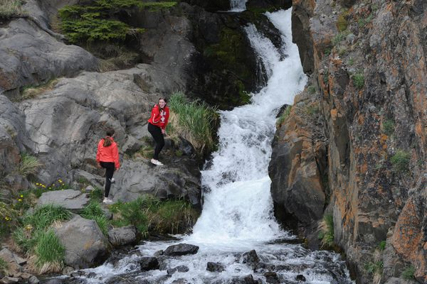 Hikers take in the view while scrambling up the rocks along McHugh Creek in the Chugach State Park on Sunday, May 19, 2019. (Bill Roth / ADN)