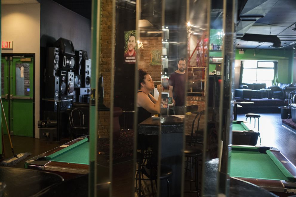 Amanda Brooker, 42, smokes at Higher Limits, a marijuana lounge in Windsor. (Brittany Greeson for The Washington Post)