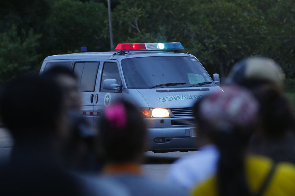 An ambulance believed to be carrying one of the rescued boys from the flooded cave heads to the hospital in Chiang Rai as divers continue to extract the remaining boys and their coach trapped at Tham Luang cave in the Mae Sai district of Chiang Rai province, northern Thailand, Tuesday, July 10, 2018. Thai Navy SEALs say all 12 boys and their coach were rescued from the cave, ending an ordeal that lasted more than 2 weeks. (AP Photo/Vincent Thian)
