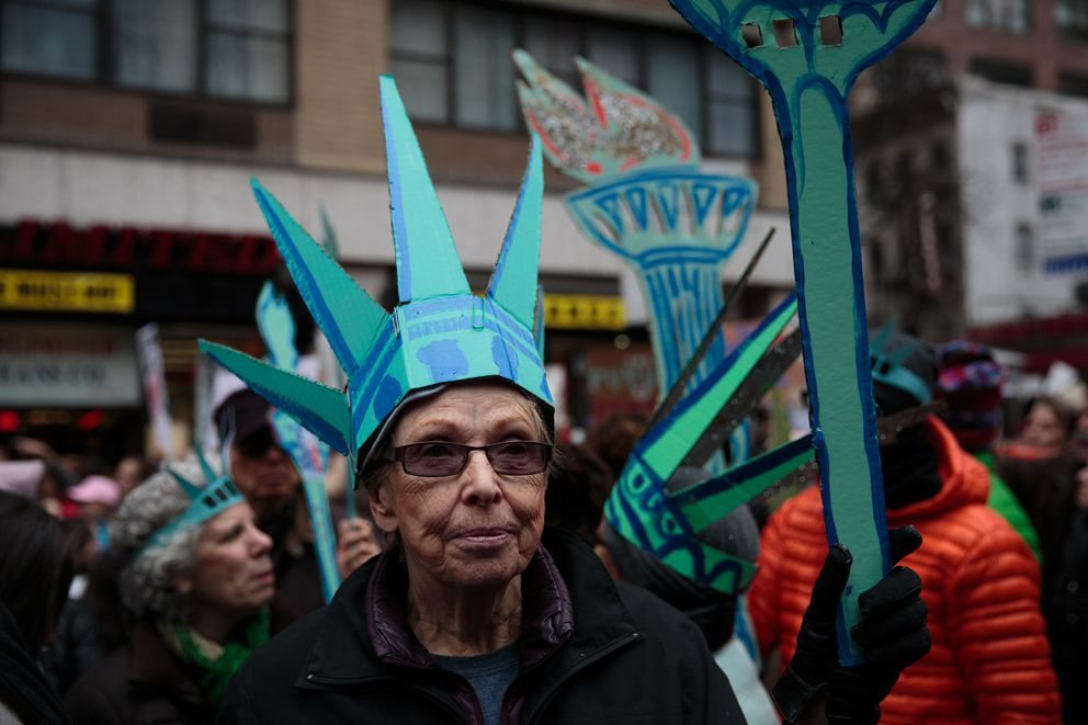 A woman wears a Statue of Liberty crown and holds a torch at the Women's March in New Yorkon Saturday. (Sara Hylton/The New York Times)