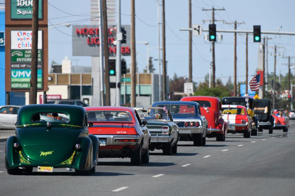 Drivers from the Antique Auto Mushers of Alaska, British Sports Cars Alaska and Midnight Sun Street Rod Association head west on Northern Lights Boulevard. (Marc Lester / ADN)
