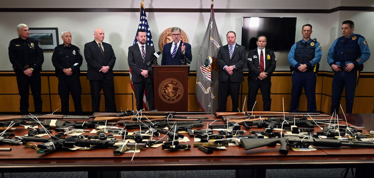 U.S. Attorney Bryan Schroder, center, speaks during a press conference in Anchorage on Wednesday, Feb. 26, 2020, about