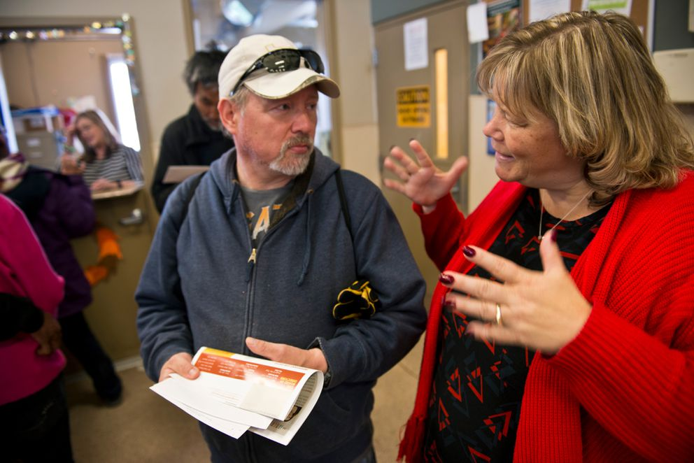 Bean's Cafe executive director Lisa Sauder, right, talks with Bean's Cafe client Patrick DeCamp on April 4, 2016. (Marc Lester / Alaska Dispatch News)