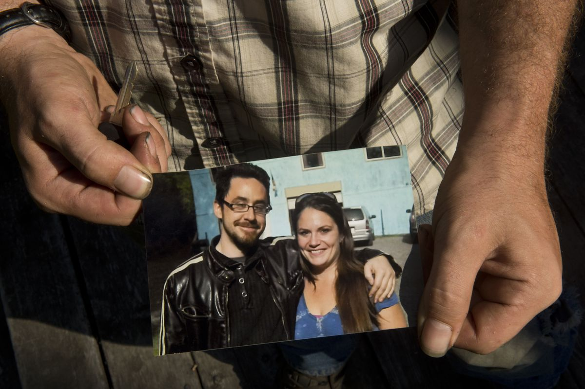 Johnny Hammons Jr., of Wasilla, holds a photograph of himself with his sister Amanda Hammons, who died in an Anchorage house fire in July. Photographed August 8, 2019. (Marc Lester / ADN)