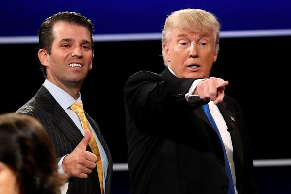 FILE PHOTO: Donald Trump Jr. (L) gives a thumbs up beside his father Republican U.S. presidential nominee Donald Trump (R) after Trump's debate against Democratic nominee Hillary Clinton at Hofstra University in Hempstead, New York, U.S. September 26, 2016. REUTERS/Mike Segar/File Photo