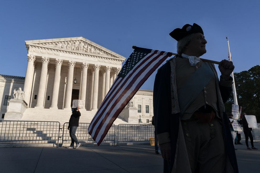 James Manship, playing George Washington, rallies in support of the nomination Amy Coney Barrett to the Supreme Court, outside the Supreme Court, Monday, Oct. 26, 2020, on Capitol Hill in Washington. (AP Photo/Jacquelyn Martin)