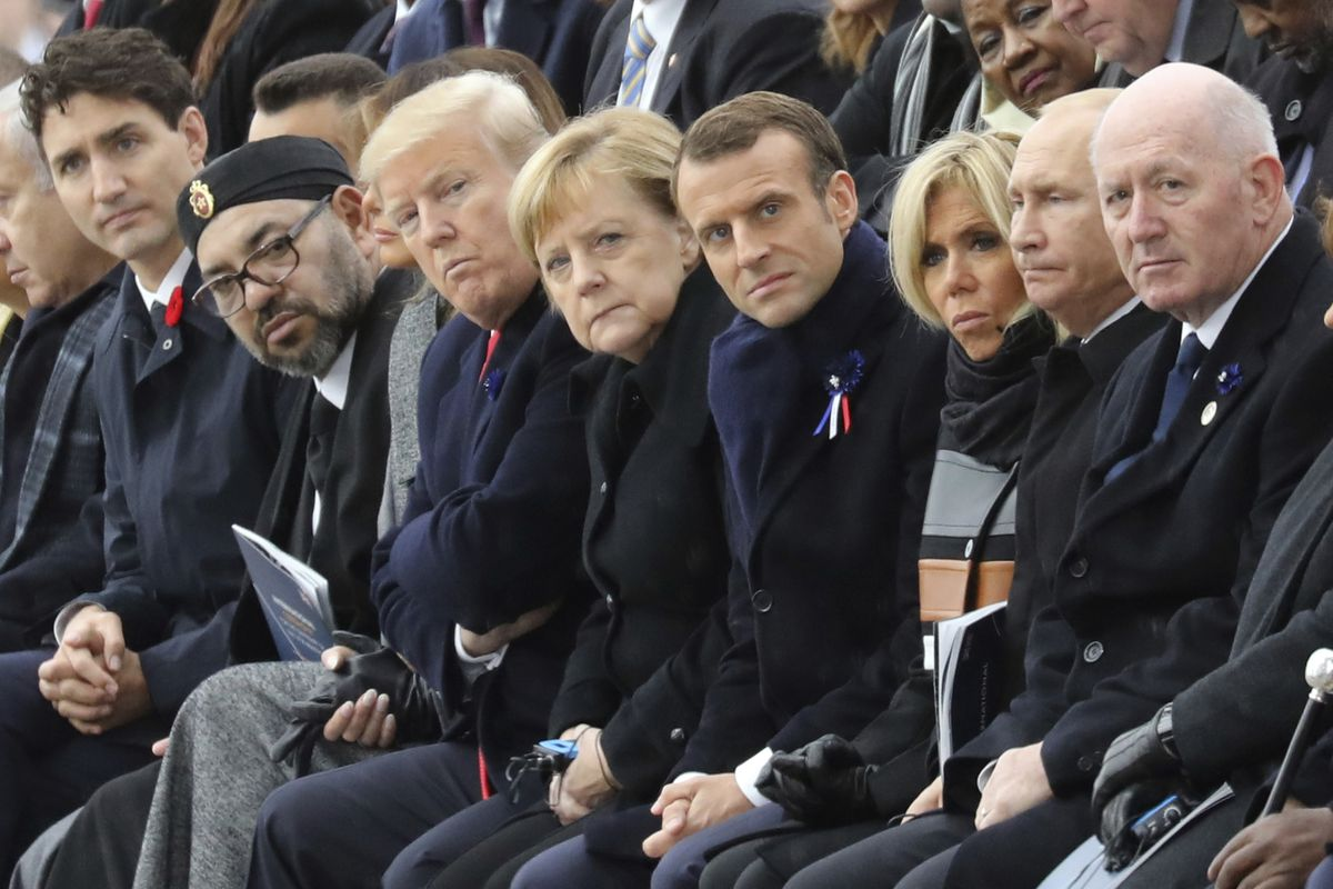 (From L) Canadian Prime Minister Justin Trudeau, Morocco's Prince Moulay Hassan, Moroccan King Mohammed VI, US First Lady Melania Trump, US President Donald Trump, German Chancellor Angela Merkel, French President Emmanuel Macron and his wife Brigitte Macron, Russian President Vladimir Putin and Australian Governor-General Peter Cosgrove attend a ceremony the Arc de Triomphe in Paris, France, as part of the commemorations marking the 100th anniversary of the 11 November 1918 armistice, ending World War I, Sunday, Nov. 11, 2018. (Ludovic Marin/Pool Photo via AP)