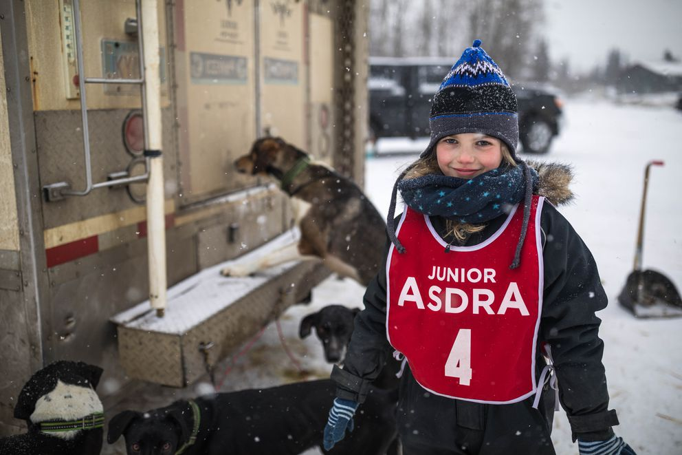 Leonie Tetzner, 8, poses for a photo after winning the 1-dog class race Saturday, Feb. 16, 2019 during the Junior World Championship Sled Dog Race at Tozier Track. Tetzner and her family, who live in Burg, Germany, come to Alaska nearly every year with around 30 dogs. Leonie's father, Michael Tetzner, competes in the Fur Rondy World Championships. (Loren Holmes / ADN)