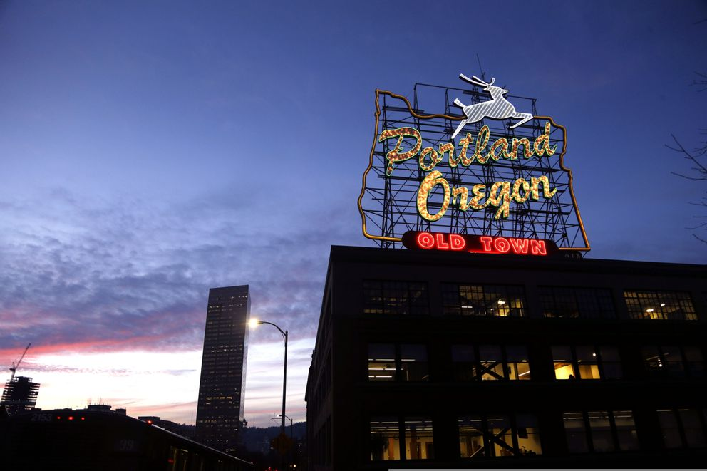 This Jan. 27, 2015, file photo, shows the 'Portland, Oregon ' sign in downtown Portland. (AP Photo/Don Ryan, File)
