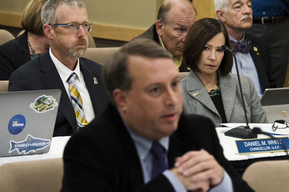 UAF Chancellor Daniel White, top left, and UAA Chancellor Cathy Sandeen listen as Mike Barnhill, policy director for the state Office of Management and Budget, presents to the Board of Regents. (Marc Lester / ADN)
