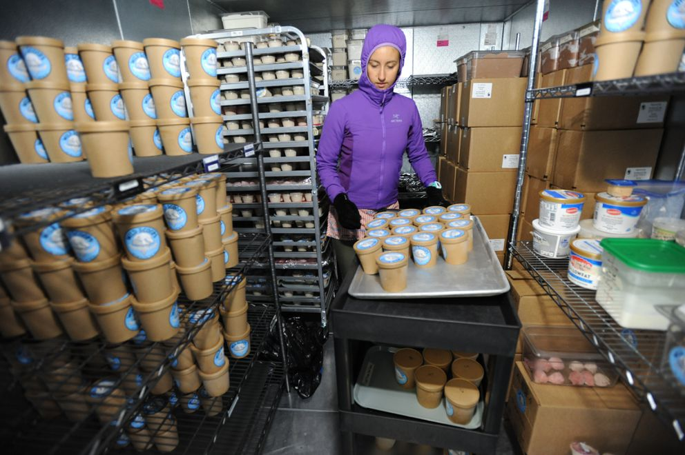 Laurel Safranek stocks a freezer with freshly made Wild Scoops Handcrafted Alaskan Ice Cream in their Fairview test kitchen on April 6. (Bill Roth / Alaska Dispatch News)