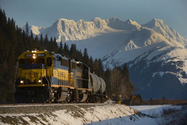 An Alaska Railroad freight train travels near Girdwood, AK next to the Seward Highway and Turnagain Arm south of Anchorage, AK on Thursday, February 14, 2019. (Bob Hallinen photo)