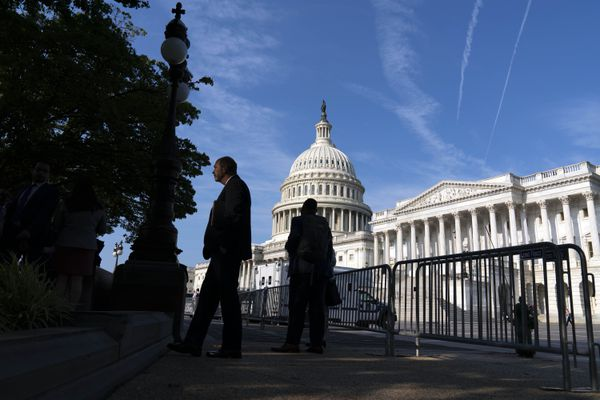 The U.S. Capitol is seen as people walking on the sidewalk with a fence, in Washington, Thursday, July 22, 2021. Speaker of the House Nancy Pelosi, D-Calif., discussed with reporters her reasons for rejecting two Republicans chosen by House GOP leader Kevin McCarthy to be on the committee investigating the Jan. 6 Capitol insurrection. (AP Photo/Jose Luis Magana)