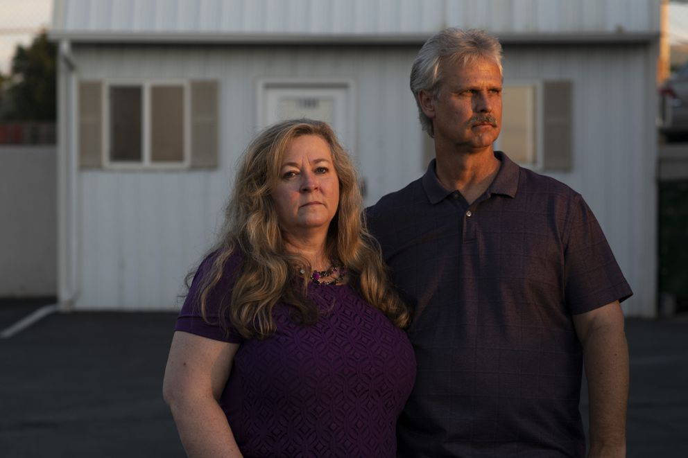 Tammy Nelson and Scott Nelson, co-owners of Fender Menders in Broomfield, Colo. The Nelsons had to lay off themselves and three employees after their PPP funding ran out. (Photo by Rachel Woolf for The Washington Post)