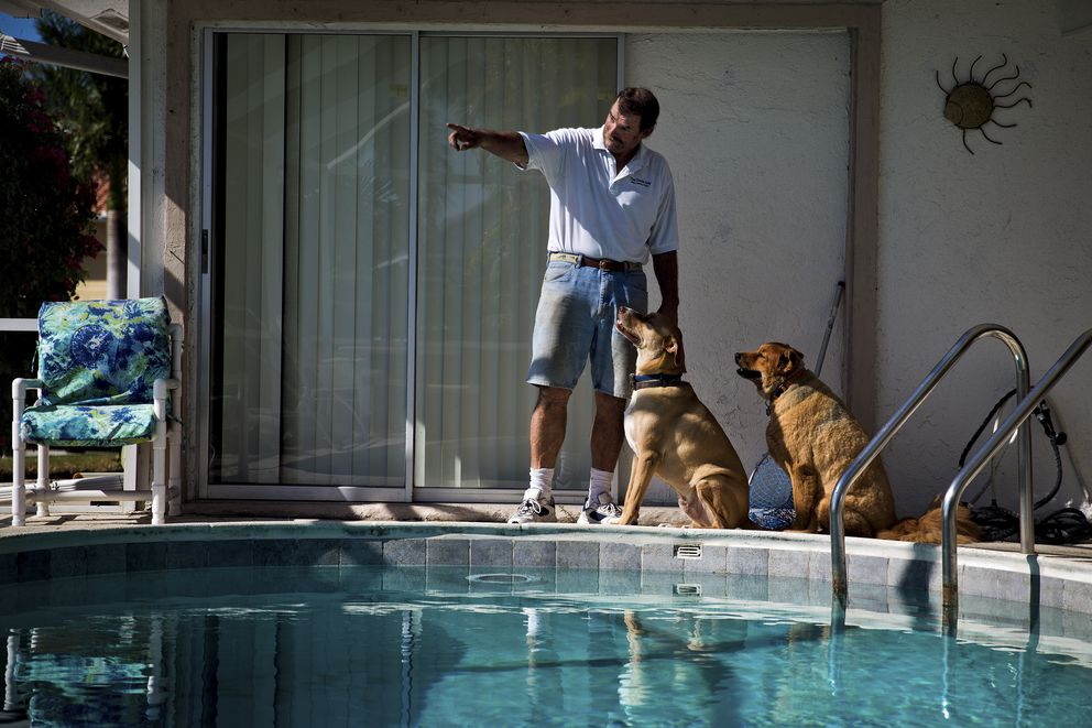 Eric Karlson, who was successfully treated for non-Hodgkin lymphoma by Dr. Steven Rosenberg with what would eventually become the drug KTE-C19, at his home with his dogs Leo and Abby in Marco Island, Fla., Dec. 14. (Scott McIntyre/The New York Times)